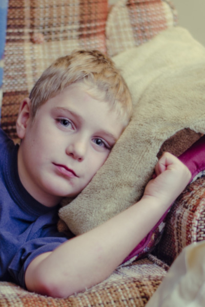 Sick kid on couch